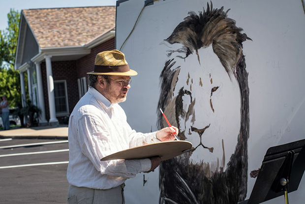 "Artist Mark Balma paints a huge mural of Cecil in Dr. Walter Palmer's parking lot on July 29, 2015 at River Bluff Dental in Bloomington, Minn. Bala went to school in the Twin Cities and was visiting friends when he decided to come down for a ""silent protest"" against Dr. Walter Palmer and the illing of the lion in ZImbabwe. He also painted the frescoes at the University of St. Thomas Law School. He hopes to see the painting to raise money for wildlife preservation efforts. Photo by Glen Stubbe/Minneapolis Star Tribune/TNS/ABACAPRESS.COM"